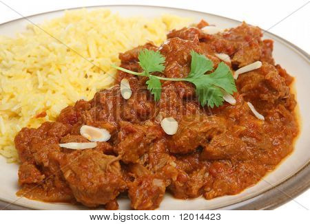 Indian Rogan Josh lamb curry with pilau rice.