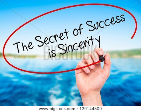 Man Hand Writing The Secret Of Success Is Sincerity With Black Marker On Visual Screen.