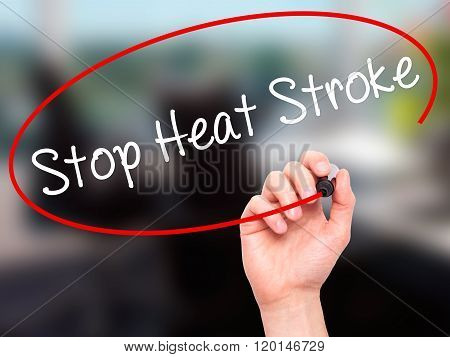 Man Hand Writing Stop Heat Stroke With Black Marker On Visual Screen.