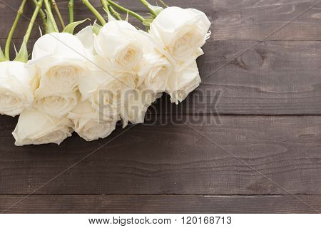 White Roses Are On The Wooden Background