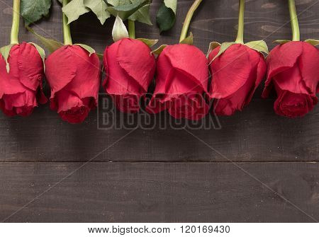 The Arrangement Of Red Roses Flower On The Wooden Background