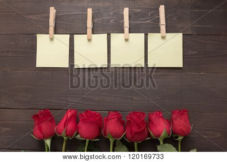 The Arrangement Of Red Roses Flower With Sticky Notes Are On The Wooden Background