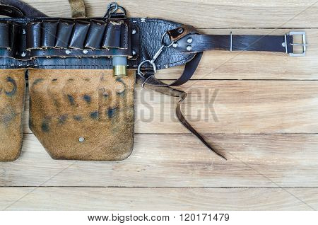 Old Leather Hunting  Bandoleer On A Wooden Table
