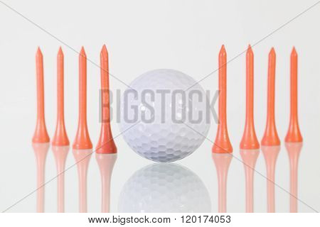 Golf Ball And Pink Tees On The Glass Table