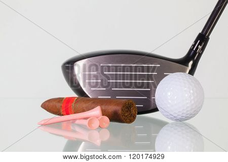 Golf Driver And Different Cigars On A Glass Desk