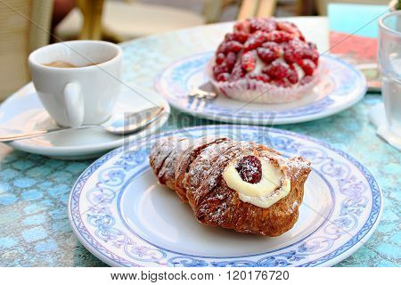Breakfast with italian cakes and cup of coffee