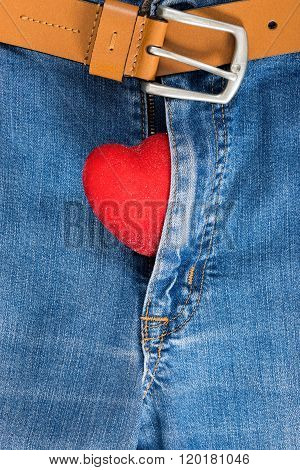 Red Heart Sticking Out From Zipper. Jeans Concept.