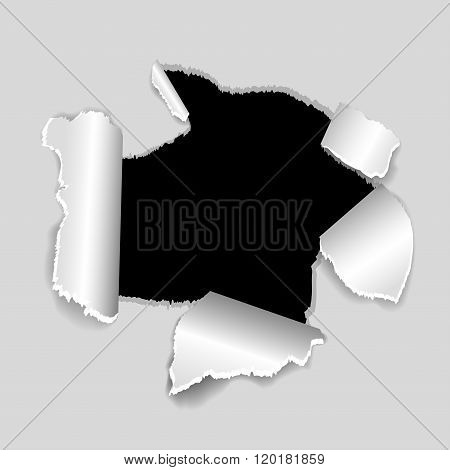 The black torn hole in a white paper
