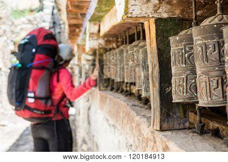 Trekker spinning praying wheel.