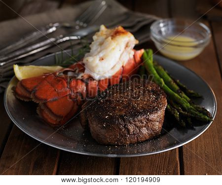 steak and lobster dinner in low key lighting