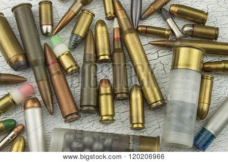 Different types of ammunition. Bullets of different calibers and types. The right to own a gun. Sales of weapons and ammunition. poster