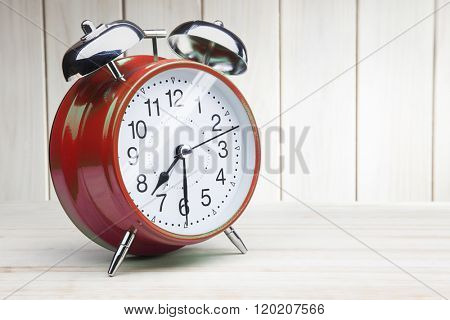 classic red alarm clock morning wake-up time