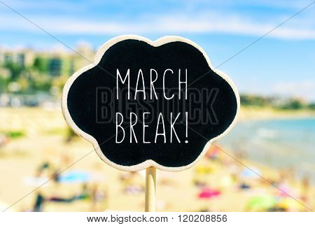 closeup of a black signboard in the shape of a thought bubble with the text march break written in it, in front of a blurred beach with many people bathing and sunbathing