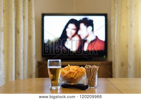 Tv, Television Watching (romance Movie) With Snacks Lying On The Table