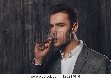 Close Up Portrait Of Pretty Businessman Smoking A Sigar