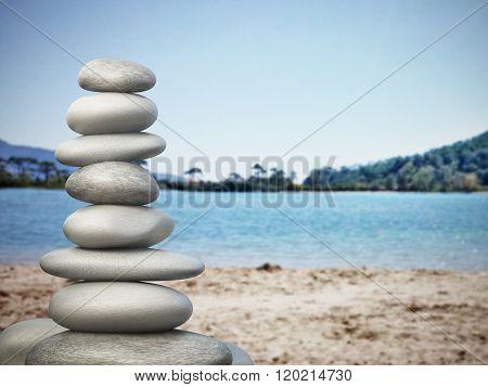 Balanced Stones On The Beach