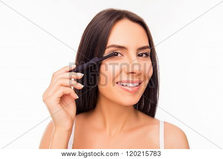 Portrait Of Cute Girl Doing Maquillage With Brash Of Mascara