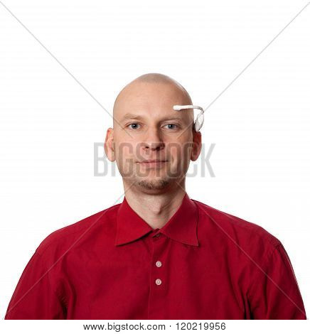 Portrait of young man with handmade EEG (electroencephalography) headset on head. Isolated on white background. poster