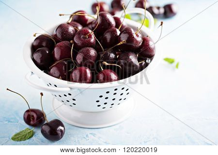 Fresh ripe sweet cherries in a colander