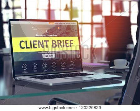 Client Brief on Laptop in Modern Workplace Background.