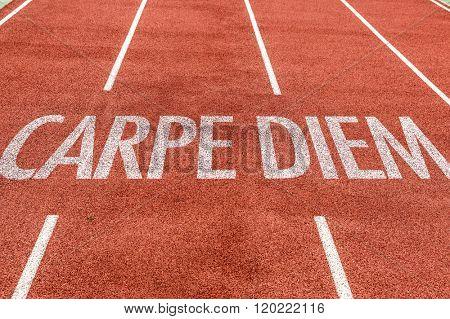 Carpe Diem written on running track