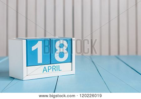 April 18th. Image of april 18 wooden color calendar on white background.  Spring day, empty space fo