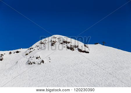 Snowy Mountains With Ski Tracers