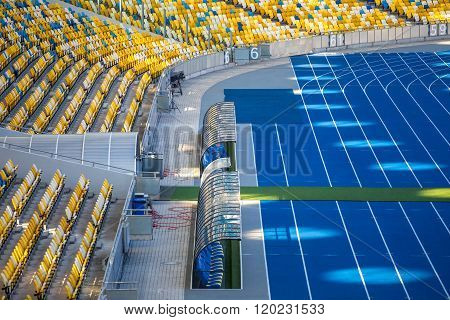 Blue Running Treadmills with white stripes on Olimpiyskiy stadium