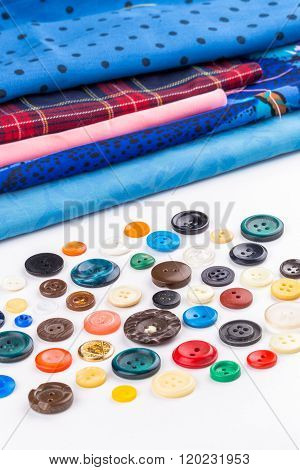 Colored Buttons And Cloth On White Background
