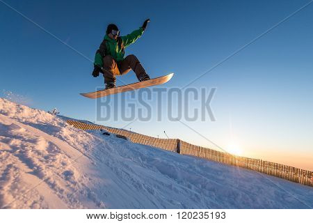 Snowboarder At Jump