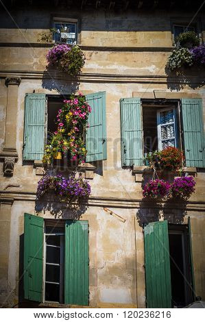 4 Painted windows in Arles. Provence, France