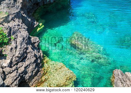 View of cliffs rocks above great Cyprus lake tranquil turquoise water at beautiful Bruce Peninsula