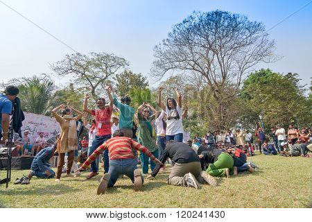 KOLKATA INDIA - FEBRUARY 8 2015 : Young crowd from different cultures across the world are dancing in Sufi Sutra International Dance festival on field. It is a popular annual dance progarm in Kolkata.