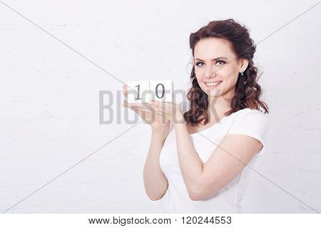 Girl In White T-shirt Holding Number Ten.