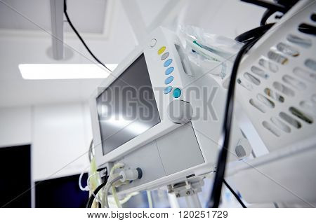 medicine, health care, emergency and medical equipment concept - extracorporeal life support machine at hospital ward or operating room