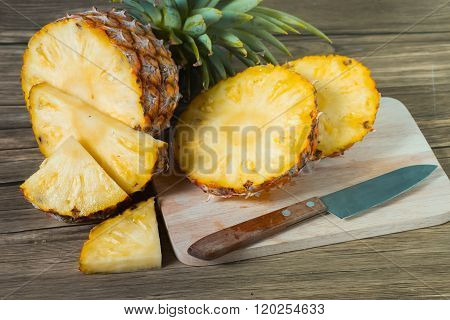Pineapple On The Wood Texture Background