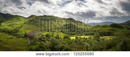 A panorama of the Scottish Highlands and the Glenfinnan Viaduct on the West Highland Line in Glenfinnan, Lochaber. Scotland, UK.