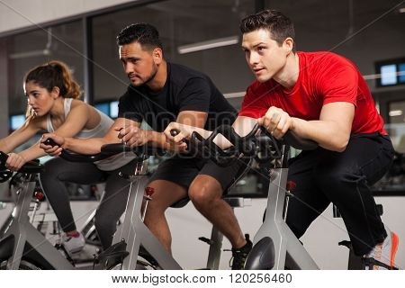 Three People Doing Cardio On A Bicycle