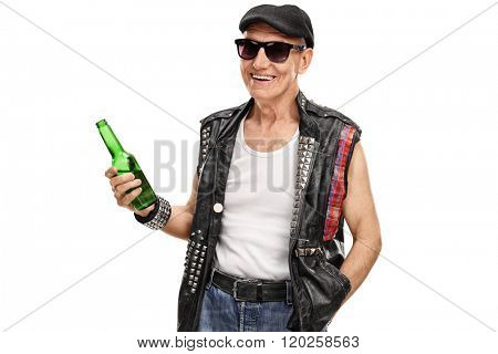 Senior punk rocker with a leather vest with pins holding a bottle of beer isolated on white background