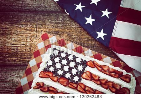 Patriotic Blueberry And Strawberry Cake With American Flag