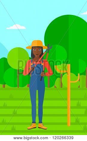 Farmer with pruner in garden.