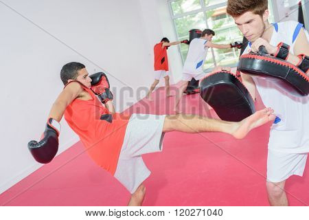 Young men in kick boxing class