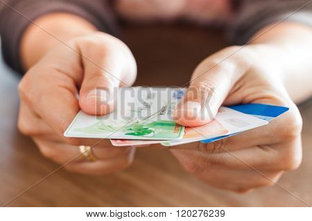 Chiang Rai, Thailand - March 3, 2016: Woman's Hand Holding Visa Card