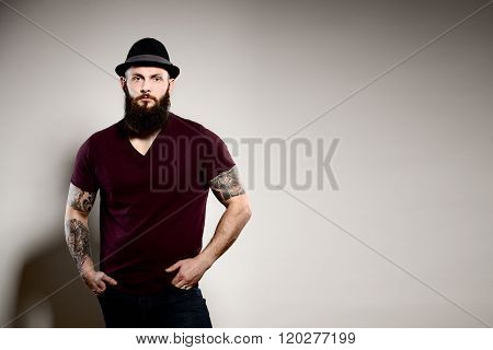 Portrait Of Standing Handsome Bearded Man In Hat