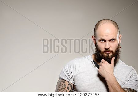 An Image Of A Man With A Beard And Tattoo