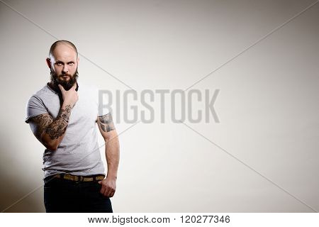 Portrait Of Tattooed Bearded Man