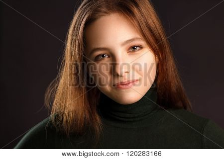 Portrait Of Redhead Woman On Dark