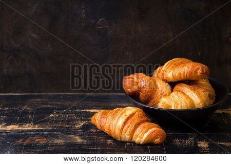 Croissants In A Black Bowl On The Dark Background