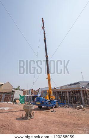 Crane Lifting Concrete Mixer Container