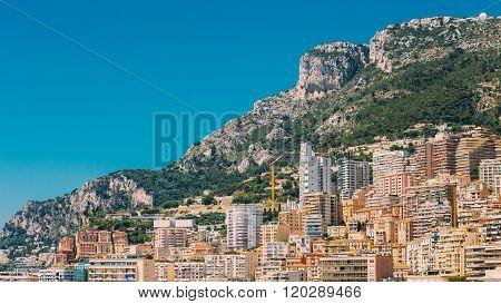 Monaco, Monte Carlo architecture on mountain hill background. Ma